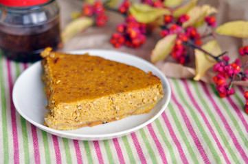 Tasty slice of a pumpkin pie on a plate