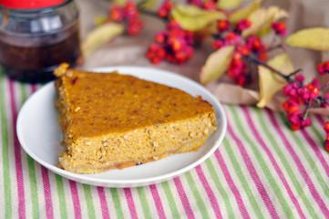 Tasty slice of a pumpkin pie on a plate