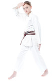 Pretty young girl in karate uniform