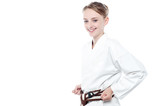 Smiling karate girl isolated over white