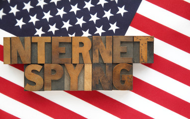 the words 'internet spying' on a USA flag