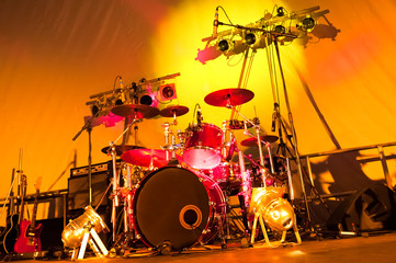 rock band stage set-up with drums, guitars and spotlights