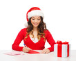 smiling woman in santa helper hat with postcard