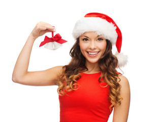 woman in santa helper hat with jingle bells