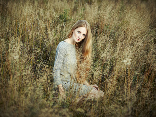 Portrait of beautiful woman on autumn field