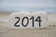 Happy New Year 2014 on a stone