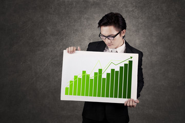 Businessman holding Graph Board