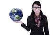 Businesswoman hold globe on white
