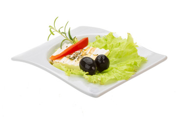 Soft cheese on salad with olives