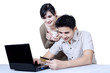 Isolated young couple online shopping