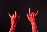 Red devil hands showing heavy metal