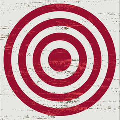 Vintage red target on white scratched background