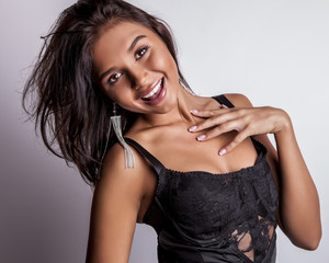 Young smiling sensual & beauty woman pose in studio.