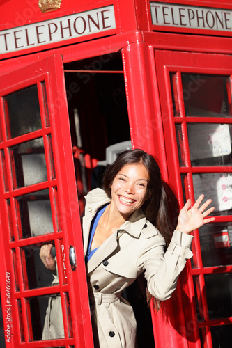 London red phone booth - woman waving happy