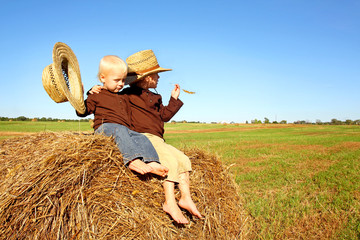 Little Boys Out in the Country on a Hay Bale