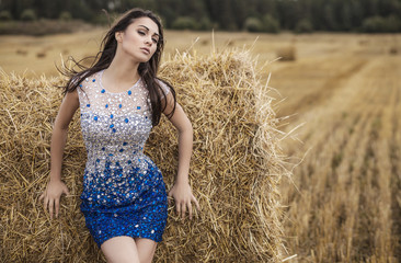 Young beauty woman in a fashionable dress outdoor.