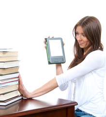 Woman compare books and new wireless reading digital ebook devic