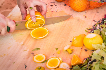 Detail of an Hand cutting Fruit without Protection