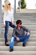 Young fashionable couple on the steps