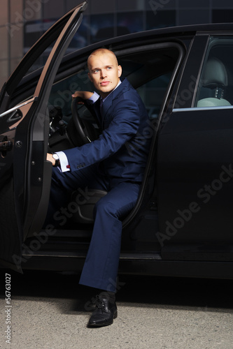 Young businessman sitting in the car