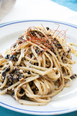 Spaghetti with olives and anchovies