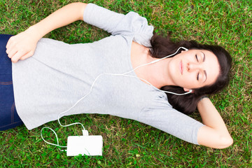 Relaxed woman listening music