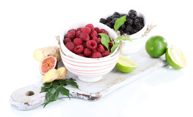 Raspberries and blackberry in small bowls