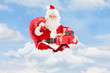 Santa Claus seated on clouds holding a bag