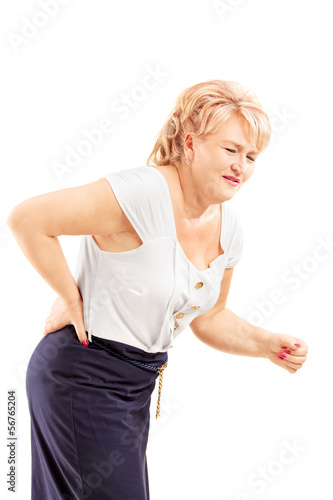 Mature blond female suffering from a back pain
