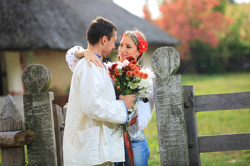 Young couple in Ukrainian style clothes outdoor