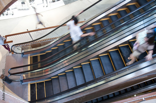Escalator with motion people