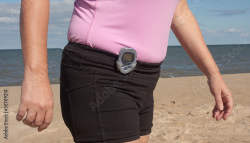 Walking With A Pedometer On The Beach