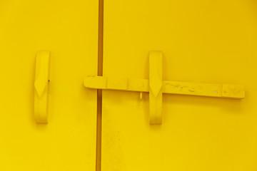 Yellow wooden door bar