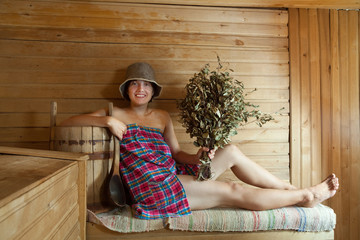 Happy girl   in sauna