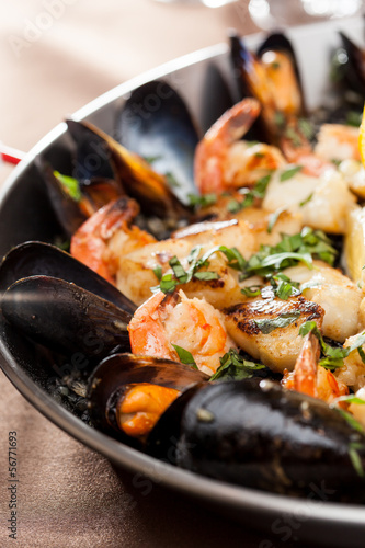 seafood paella in the fry pan - 56771693