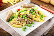 Egg pasta with sausage and peas