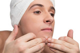 Squeezing a pimple poster