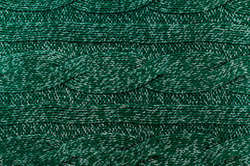 knitted jersey green background with a relief pattern. High reso