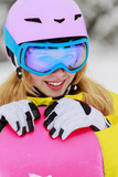 Snowboarding - portrait of young snowboarder girl