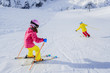 Ski, skiers on ski run - girl skiers skiing downhill