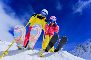 Ski and winter fun - skiers enjoying ski vacation