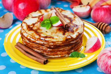 Delicious pancakes, honey apples and cinnamon