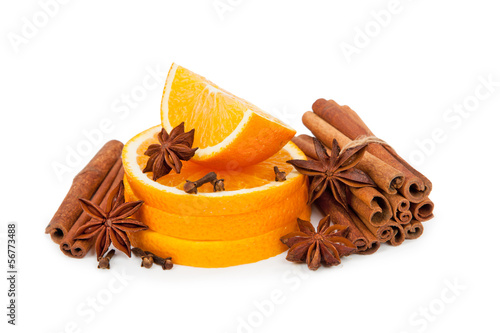 Oranges and cinnamon isolated on white background