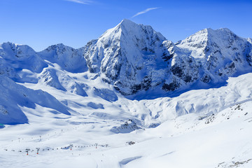 Winter mountains, ski run in Italian Alps