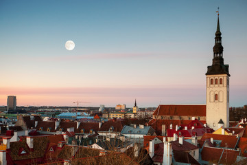 St. Nicholas Church and moon in old town of Tallinn