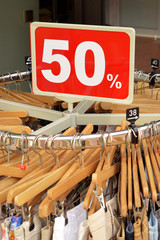 50% discount sign at a clothes rack