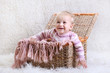 laughing baby in a basket
