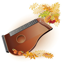 Traditional zither on white autumn background with yellow leaves
