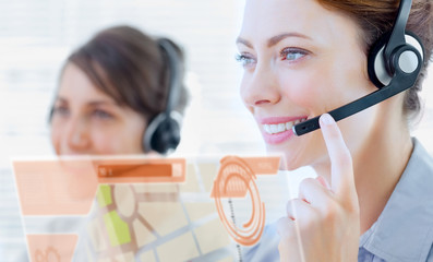 Attractive call center employee looking at futuristic interface