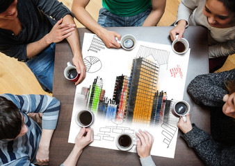 Overhead view of people sitting around table with painted city o